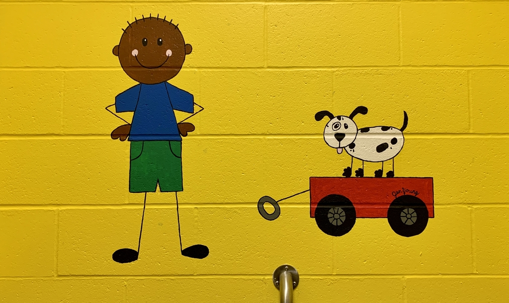 Painting on the wall with a boy and a dog on a wagon.
