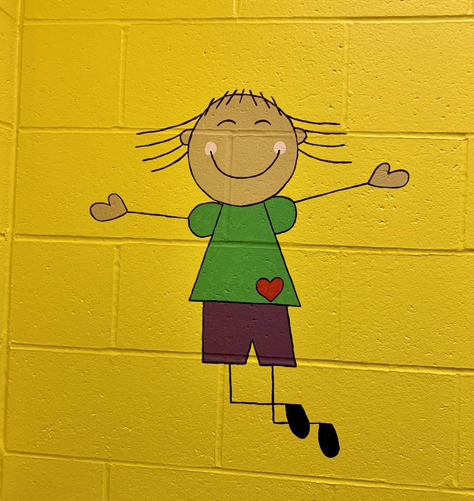 Painting on the wall of a child jumping.