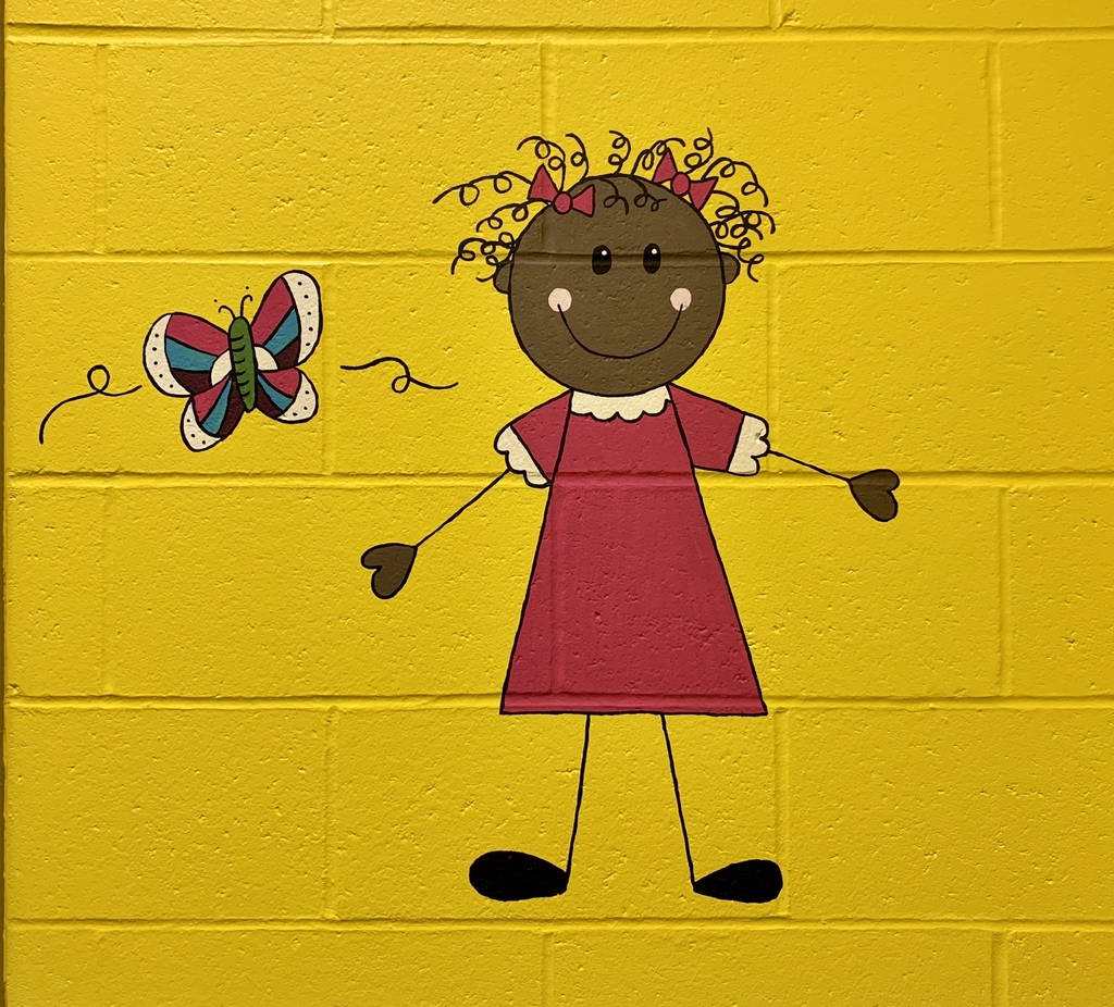 Painting on the wall of a girl and a butterfly.