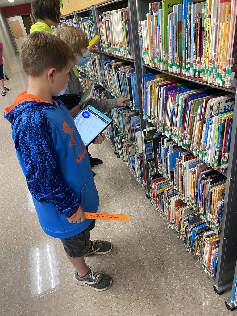 Students locating library books.